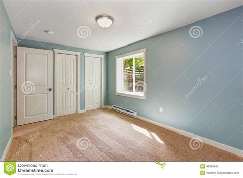 light blue bedroom with closets stock of