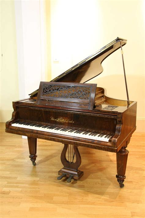 erard baby grand piano with a rosewood and a fretwork musical instruments accessories