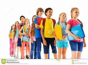 Kids Standing In The Line Holding Textbooks Stock Photo ...