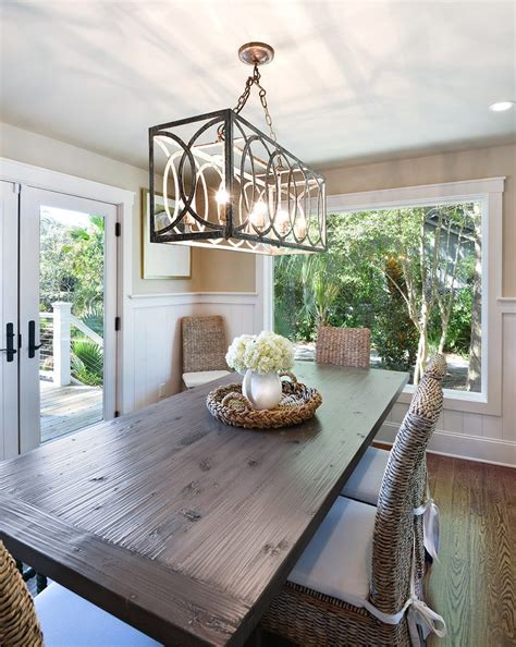 Crown Moulding Ideas For Kitchen Cabinets - beautiful cage pendant lighting dining room beach style with wood floors vacation home high