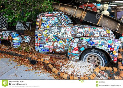 Covered Car by Car Covered With A Variety Of Stickers Editorial Stock