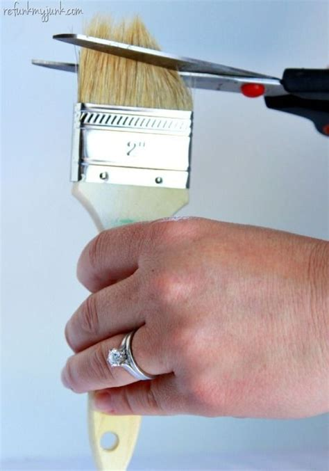 inexpensive wax brush cutting the bristles of a chip