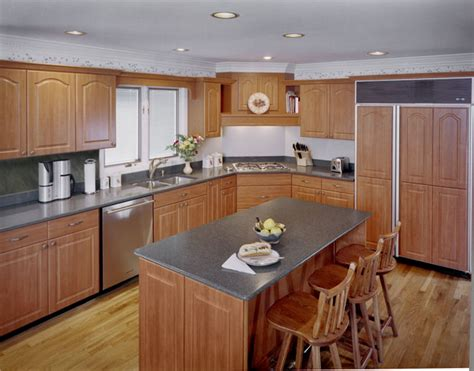 cherry cabinets with gray countertops what countertop color looks best with cherry pear cabinets