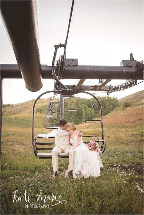 Bride And Groom On Ski Lift At Granby Ranch Wedding