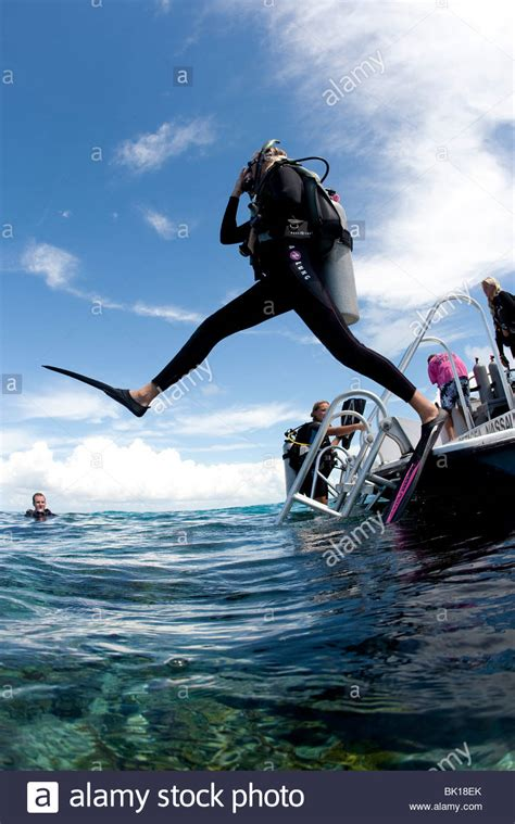 scuba diver enters water  boat  giant stride entry