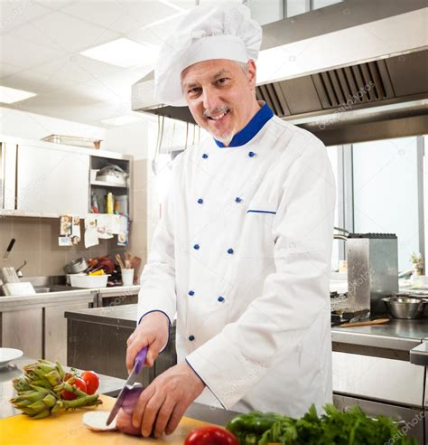 cooking chef cuisine chef cooking in his kitchen stock photo minervastock
