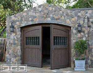 Automatic out swing carriage doors in an authentic tuscan for Carriage style garage doors for sale