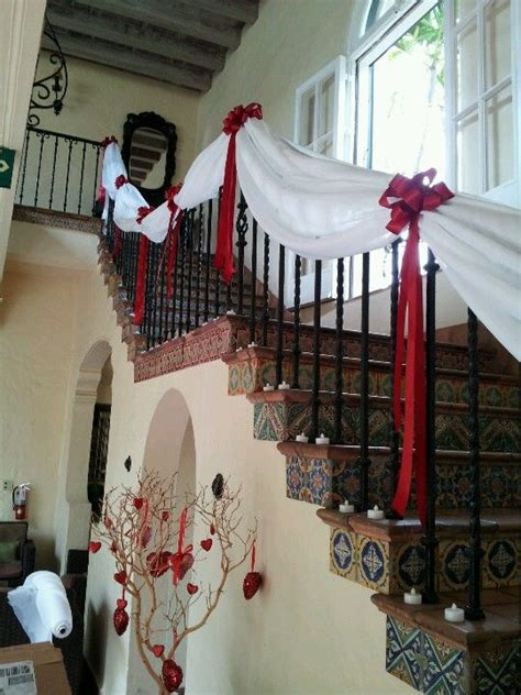 treated the staircase with some chiffon and red bows for a