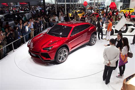 lamborghini ceo net worth lamborghini unveils its first 4 door crossover suv since