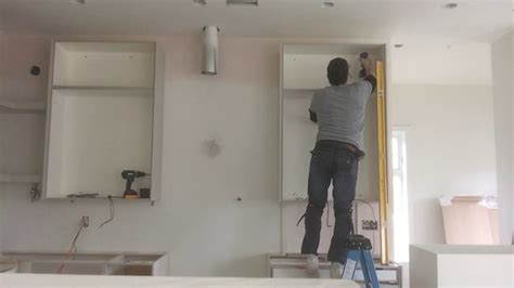 installing kitchen cabinets youtube how to install kitchen cabinets oliver custom interiors