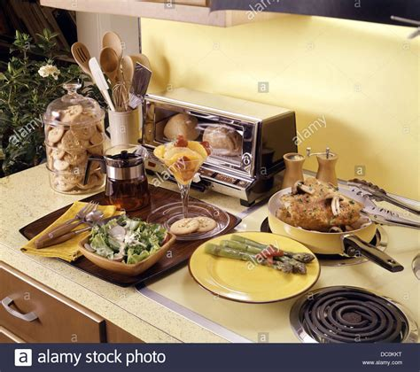 1960s 1970s MEAL PREPARED WITH KITCHEN APPLIANCES CHICKEN