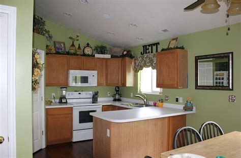 pastel green kitchen kitchen light green kitchen wall color and oak wood 1421