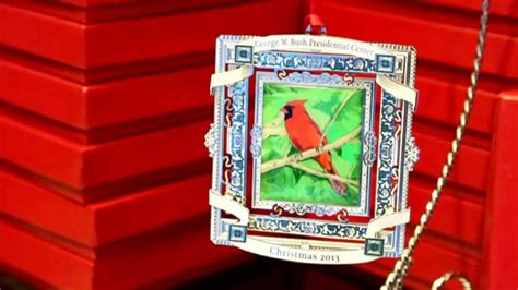 george w bush sells cardinal painting christmas ornament