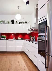 Red splashback white cabinets silver appliances and wooden for Interior design kitchen splashbacks