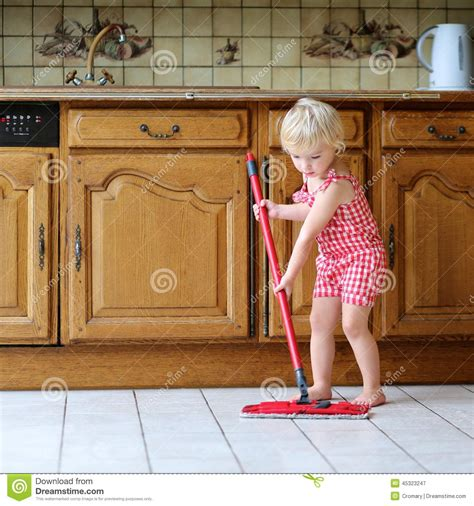 cleaning the kitchen floor toddler mopping kitchen floor stock photo image 5464