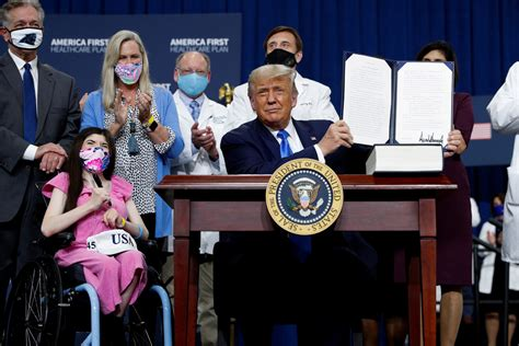 trump health care order plan donald conditions signs preexisting unveils protecting executive healthcare president existing pre carolina north signed charlotte