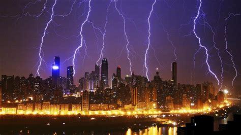 lightning in city wallpaper hd wallpaper