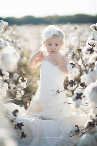 baby in mom39s wedding dress eastern nc photographer With baby wedding dress