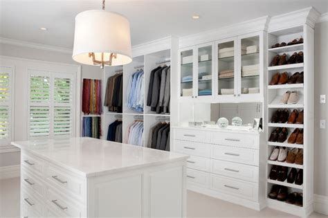 white painted maple wood walk in closet dressing room