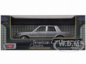 1983 Plymouth Reliant Silver 1  24 Diecast Car Model By