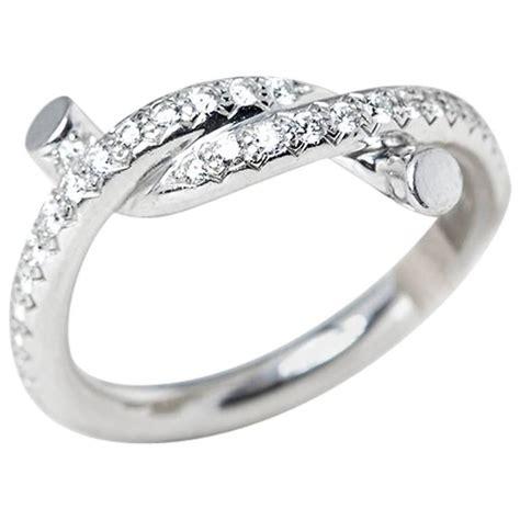 cartier 0 32 carat diamond white gold entrelac 233 s ring at 1stdibs