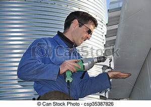 Stock Photo of plumber at work - A plumber attaching ...
