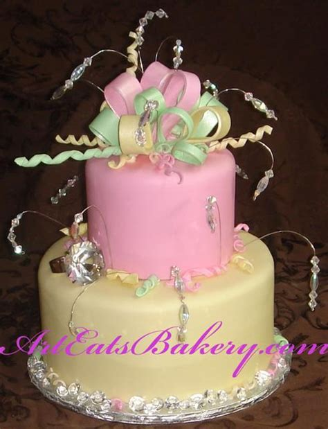 home design gold two tier pink and yellow fondant baby shower cake with bow
