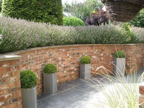 17 best ideas about brick wall gardens on