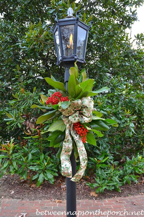 decorate a lantern for christmas with fresh greenery