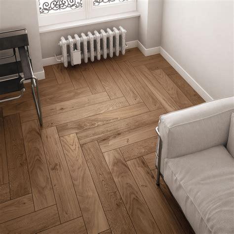 herringbone wood tile suelos de parquet the herringbone pattern achieves a contemporary effect with wood look ceramic