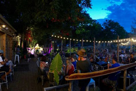 Right outside of the front doors are 3 different seating areas. Cosmic Coffee and Beer Garden | Live Music & Food Trucks too
