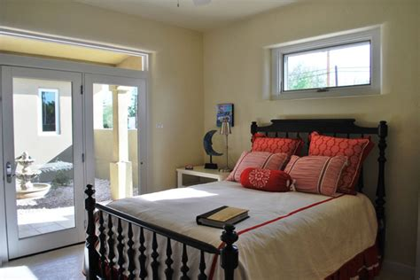 queen bed  front  window headboard drapes