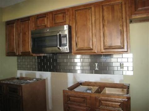 kitchen backsplash ideas for oak cabinets stainless steel backsplash with oak cabinets remodel 9054