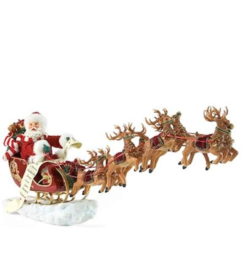 eight tiny reindeer santa claus figurines and hand