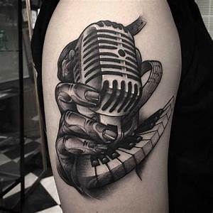 a vintage microphone tattoo on shoulder | Graphic tattoo ...