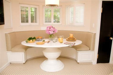 Curved Dining Banquette With A White Oval Dining Table