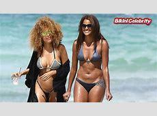 Claudia Jordan wearing a cheeky gunmetal grey bikini in