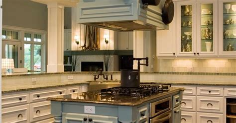 transitional kitchen  pale blue island houses  oven gas cooktop  mounted range