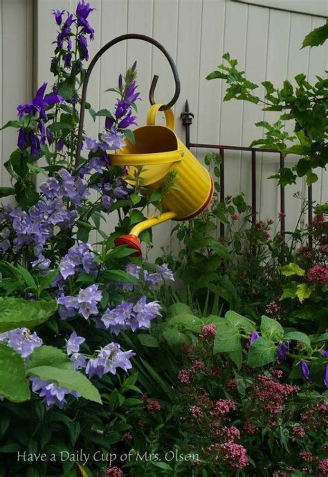 stunning watering cans decor ideas   garden