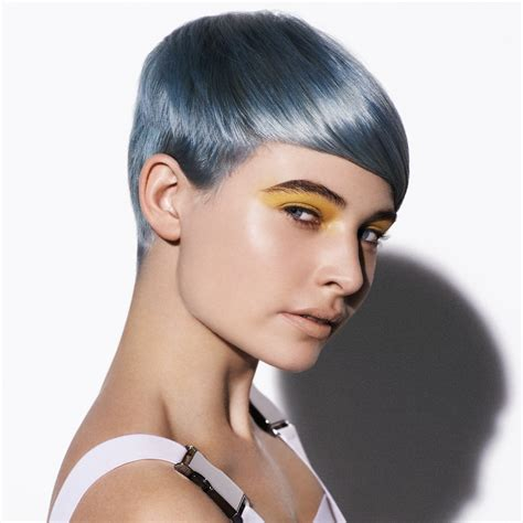 short tomboy haircut with a silver metallic blue hair color