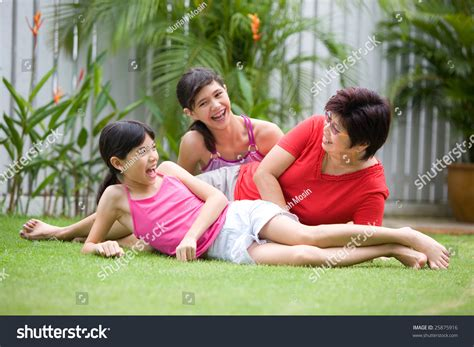 Asian Mom Having Fun With Two Young Daughters Outdoor