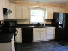 Antique White Cabinets with Black Appliances
