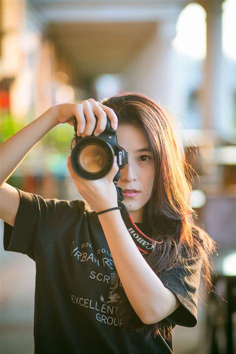 female asian photographer image  stock photo