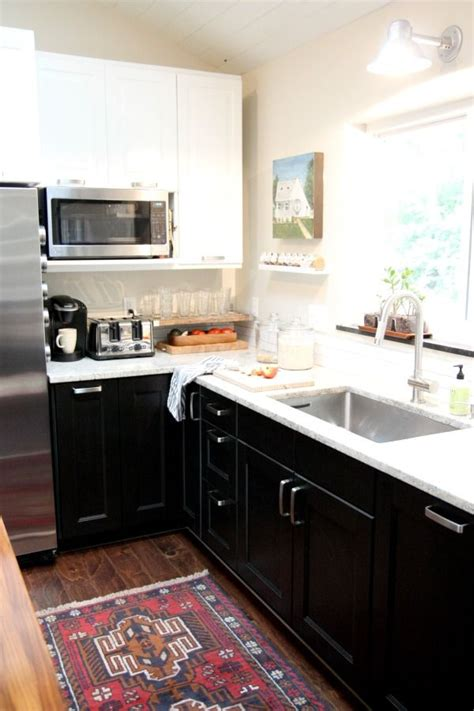 kitchen cabinet uppers white black lower cabinets and a rug that looks 2832