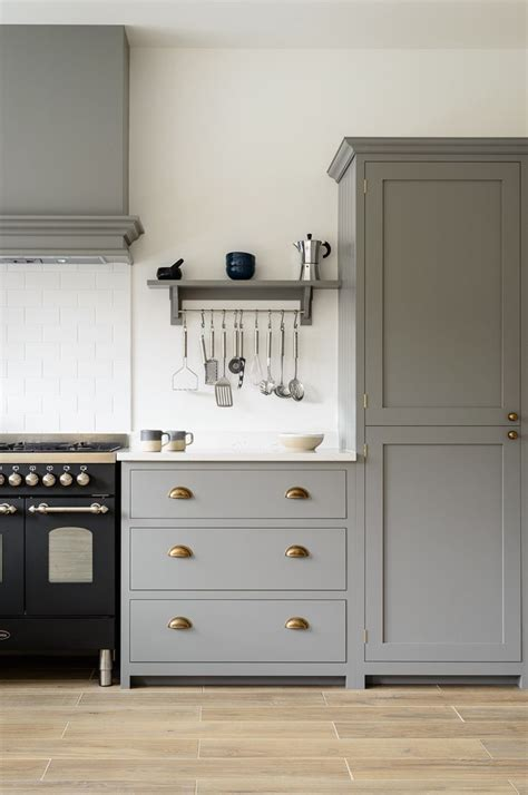 beautiful devol shaker cabinets painted in lead classic brass door furniture a lovely black