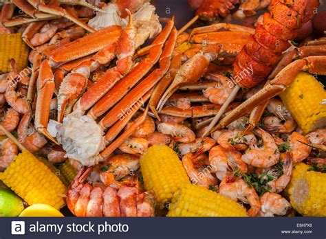 how you boil crab legs cajun seafood low country boil with corn shrimp and crab legs stock photo royalty free image