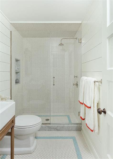 white shiplap bathroom  white herringbone floor tiles transitional bathroom