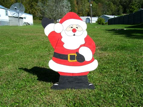 christmas waving santa claus outdoor wood