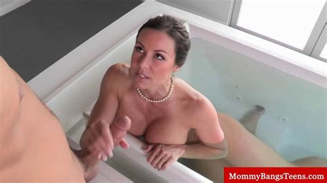 Busty Milf Caught In The Bath Sucks Cock On GotPorn