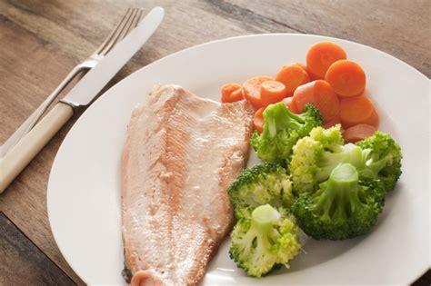 trout fillet  vegetables  stock image